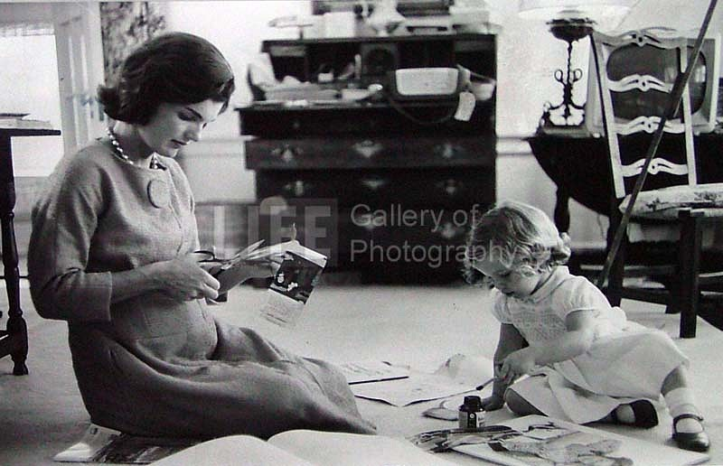 Alfred Eisenstaedt, Jacqueline Kennedy, Wife of Senator with Scissors Cutting Out Newspaper Clippings Next to Open Scrapbook as Her Young Daughter Caroline Toys with the Applicator from a Glue Bottle, At Home, Hyannis Port, MA 1960, Vintage Silver Gelatin Print
