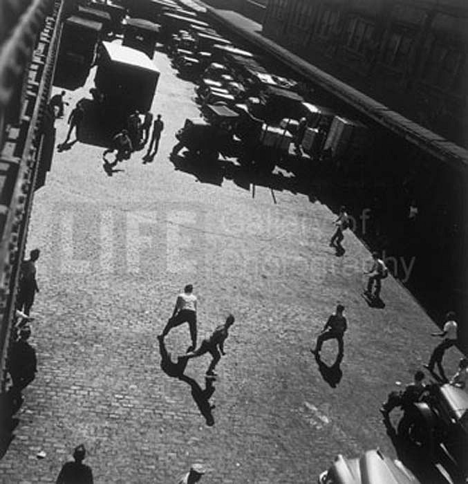 Andreas Feininger ,   Playing Ball Outside Hudson River Pier Sheds, New York  ,  1949     Silver Gelatin Print ,  16 x 20 inches