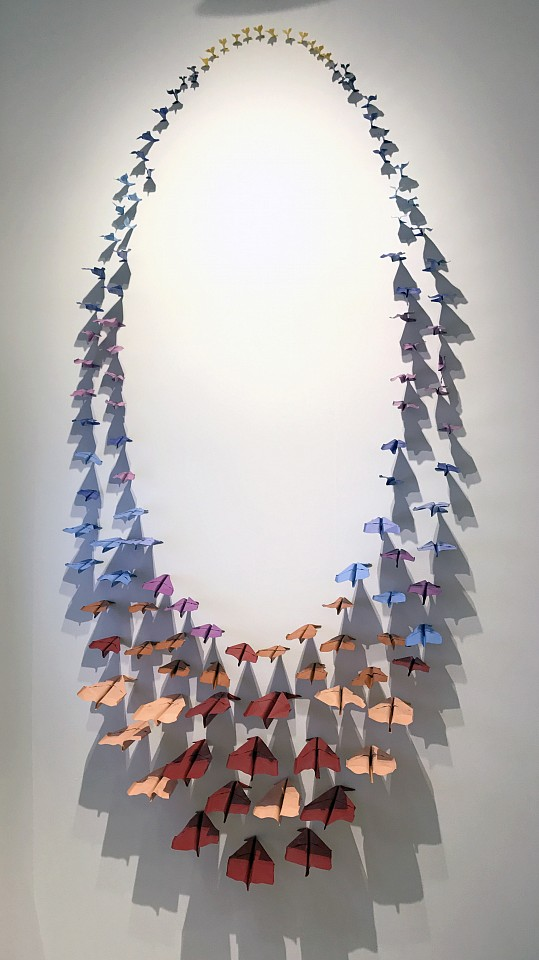 Daniele Sigalot ,   A fleet of planes apparently made of paper  hitting the wall simultaneously in geometrical harmony  ,  2017
